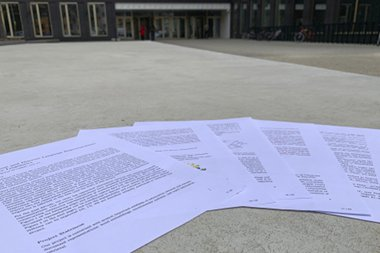 The printed GAČR project proposal laying on the concrete (pun intended) in front of the Faculty of Informatics at the Masaryk University in Brno, Czech Republic